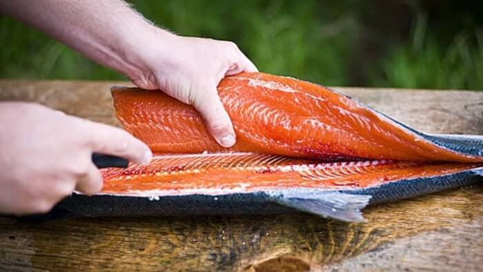 filleting and washing salmon