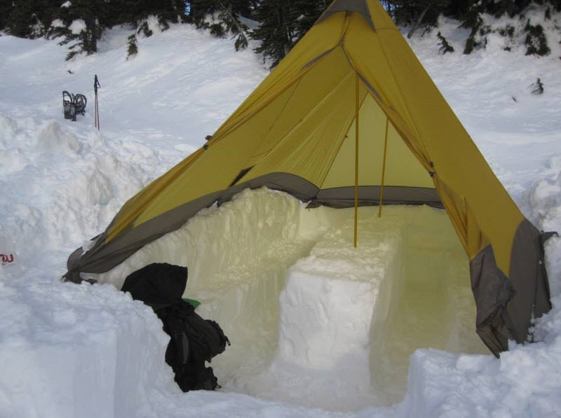 tent over trenches dug in snow