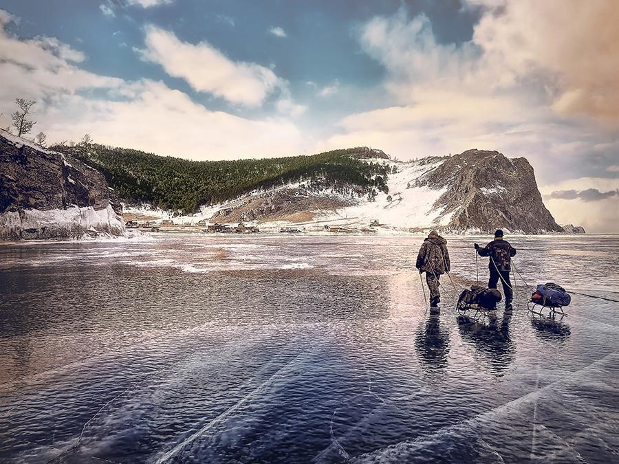 two people walking on ice