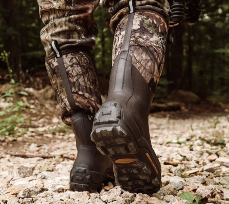 best buy rubber hunting boots - hunter wearing lined rubber boots seen from behind foot level